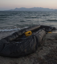 Kos, Greece - August 21st 2015 -An abandoned rubber dinghy is left abandoned on the beach by refugees, following the  cross of the sea from the town of Bodrum in Turkey.The Greek island of Kos, located five kilometres from Turkey, has seen a large influx of migrants. Kos has no migrant reception area, meaning that migrants take up residence on the promenade along the seafront. Ph.Giulio Piscitelli